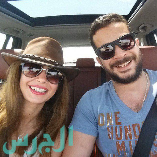 بالصورة: رومانسية داليا مصطفى وزوجها على الشاطيء