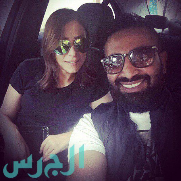 بالصورة: رومانسية ريم البارودي وأحمد سعد على المسبح