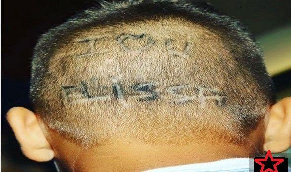 معجب إليسا كتب اسمها على رأسه